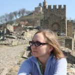 English professor Katie Burnett sits near a castle