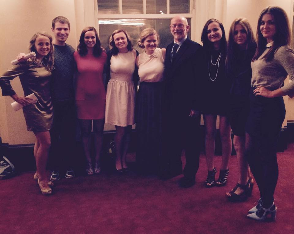 Senior Honor's students posing with professor Bob Mesle at the symphony.