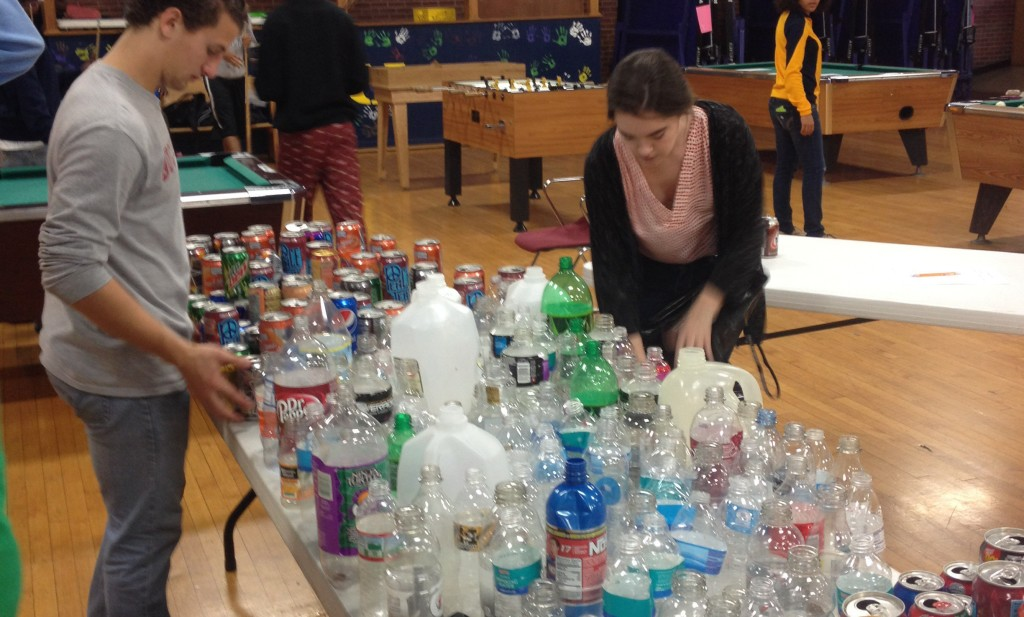 Senate Rep Brooke Lavery helps organize and count bottles for the winning house, Agape.