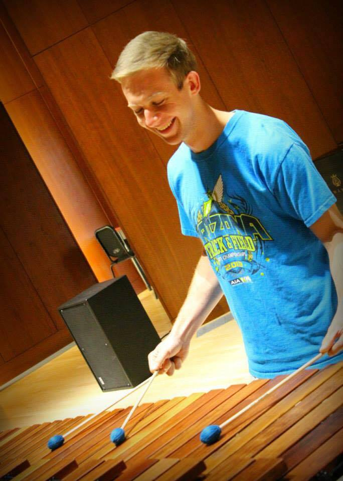 Gage entertains an audience in Carol Hall.